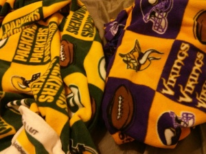 Last Christmas, Minnesota Vikings and Green Bay Packers fleece topped my wish list because I wanted to make his and hers fleece tie blankets. At first, my intention was to try a new no-sew method – by looping fleece strips into each other or something. I tried the new method on a few strips, but I wasn't impressed with the results. I just didn't like the way it looked. So, I went back to what I know best – the tie method.