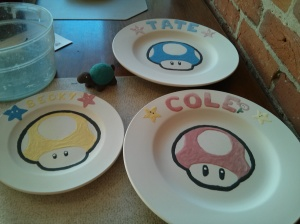I'm showing off my latest creation – super cute mushroom characters from the Mario Bros. games. I chose the mushrooms because they were the easiest to trace and paint. Maybe when I'm brave enough, I'll tackle a more difficult character – like Yoshi or Angry Birds. Anyway, I'm pretty pleased with the results of the mushroom plates.
