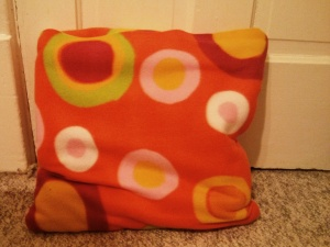 I must've been a tween when I received my first and only quillow when they were uber popular. What's a quillow, you ask? Part quilt and part pillow, of course! When the quilt isn't folded and tucked into the built-in pillow pocket, it's a lovely blanket. I sadly had to toss my quillow when one of my cats had some behavior issues and targeted my beautiful blue quillow.