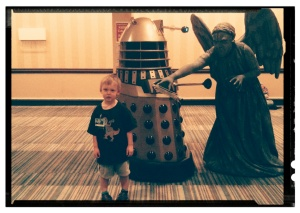 I really wanted the kid to look horrified or scared, but I think the crowd of people with cameras confused or overwhelmed him a bit. The kid wanted his picture taken with the dalek, and a nearby weeping angel added an almost comedic element to the photo since the kid didn't know the angel was behind him.