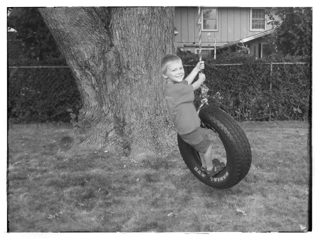 TATE ON THE TIRE SWING IN MY DAD'S BACKYARD.