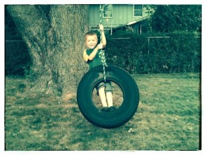 During a recent trip to Iowa, I quickly snapped a few pictures of Cole, Tova, and Tate having fun on the tire swing in my dad's new backyard.