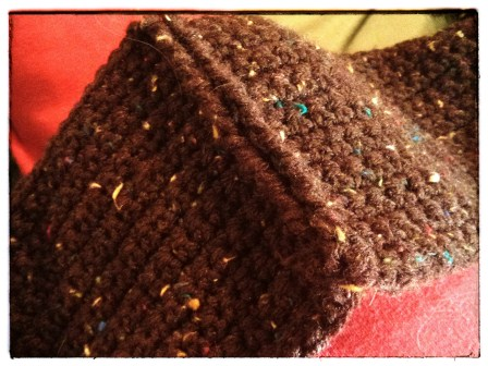 THE SPECKLED BROWN CROCHETED SCARF SEW TOGETHER.