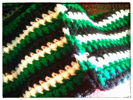 THE NEW SEAM ON THE GREEN STRIPY SCARF