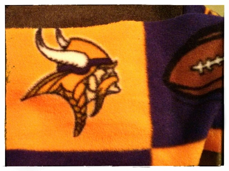 A SMALL PIECE OF VIKINGS FLEECE LEFT OVER FROM THE TIE BLANKET