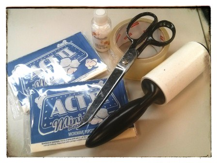 I'VE GOT THE ESSENTIALS FOR PACKING ... SCISSORS, PACKING TAPE, POPCORN, AND A LINT ROLLER.