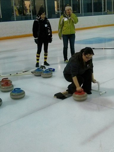 LOOK AT ME! I'm silently praying I won't fall flat on my face during a curling open house.